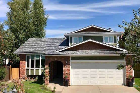 a two storey brick house with attached garage